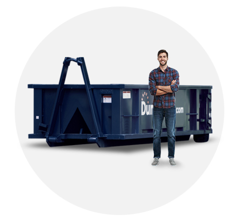 image of a ten yard dumpster with a man standing beside