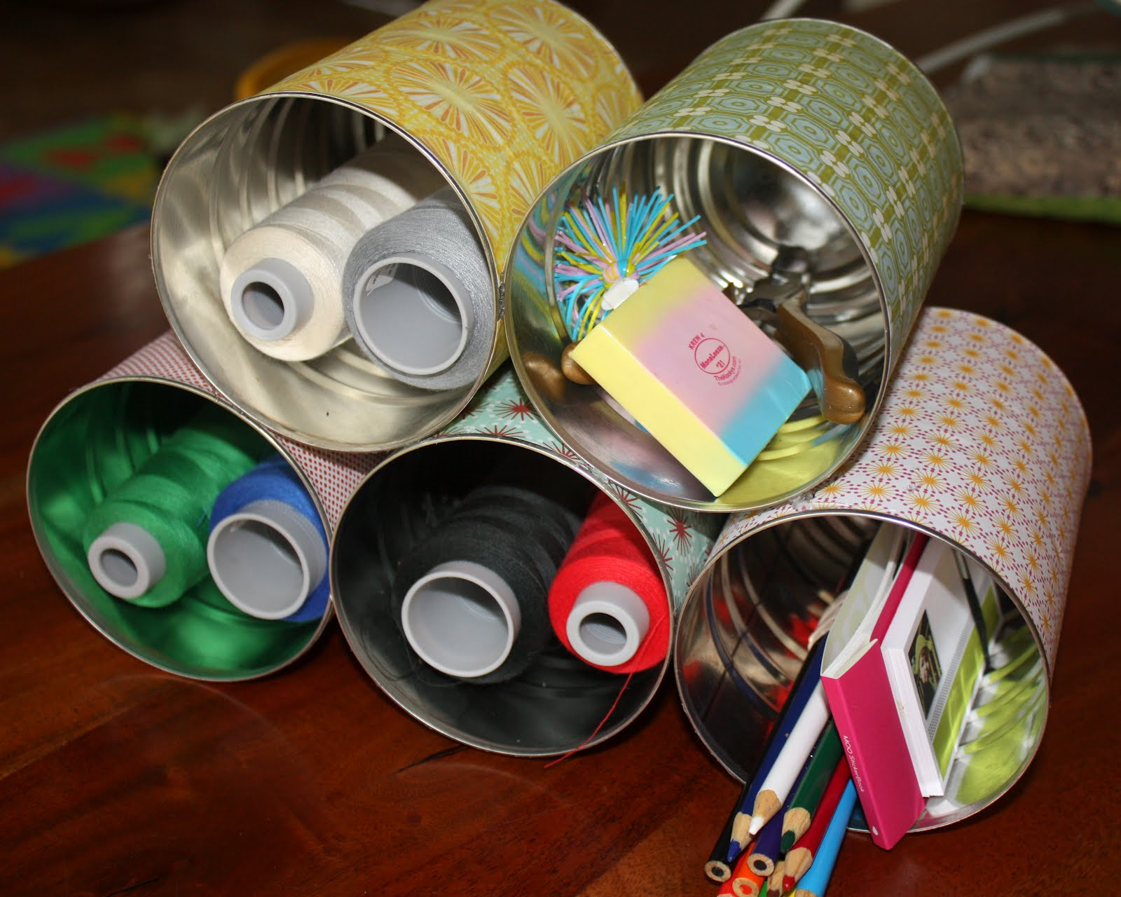 Reusing coffee cans as storage.