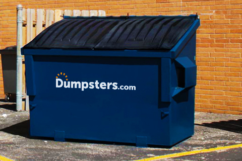 6 Yard Front Load Dumpster in Front of Brick Wall