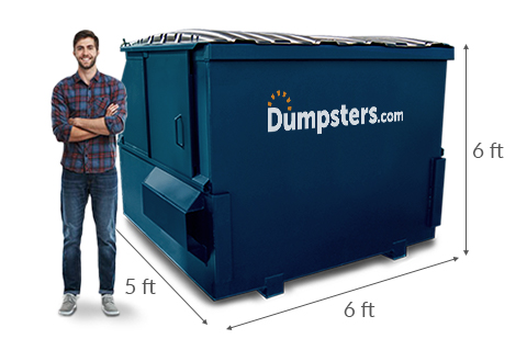 Man Standing Next to 6 yd Dumpster with Dimensions 5 feet x 6 feet x 6 feet.