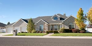 a ranch style house under a blue sky