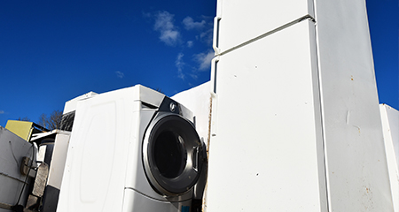 A Washing Machine and Refrigerator with a Blue Sky in the Background.