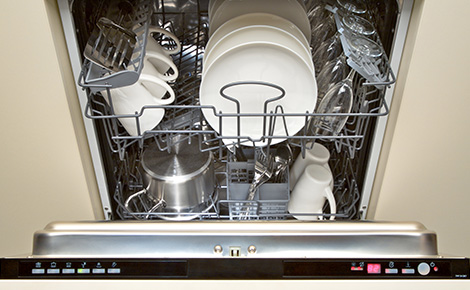 an open dishwasher full of dishes
