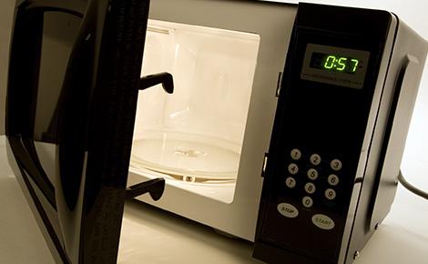 Black Microwave With Open Door.