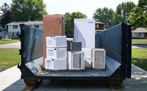 dumpster full of assorted appliances