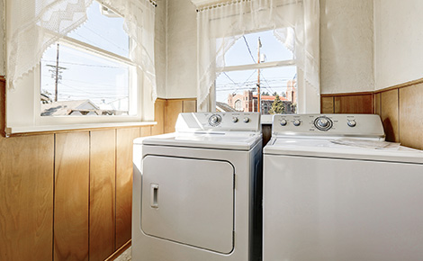 White Washer and Dryer Next to Windows