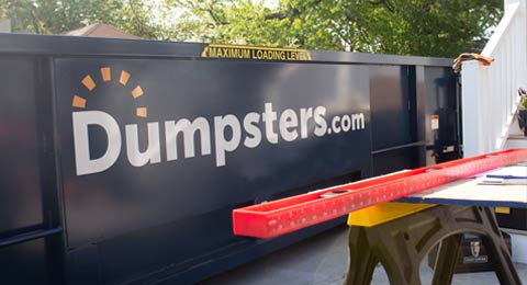 Dumpsters.com Roll Off Dumpster Outside of a Home Remodel.