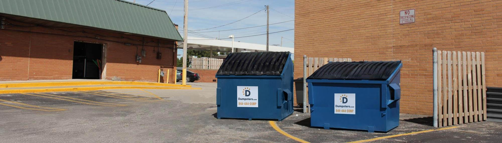 Front Load Dumpster in Commercial Parking Lot Used for Trash Pickup.