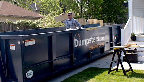 Roll Off Dumpster in Residential Driveway With Contractor.