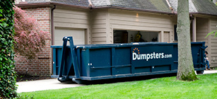 A Roll Off Dumpster in a Driveway.