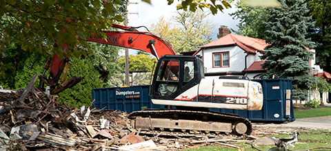 Demolition Equipment Surrounded by Debris