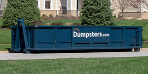 20 yard dumpster parked in a driveway