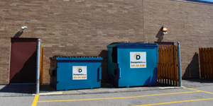 Two Commercial Dumpsters With Unlocked Gate Ready for Trash Collection Service.