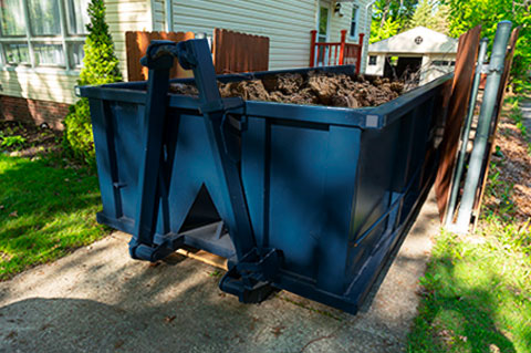 Roll Off Dumpster in Driveway Filled With Dirt.