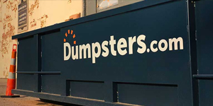 A Blue Dumpsters.com Roll Off Dumpster.