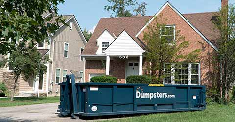 Dumpsters.com Roll Off Dumpster in Front of House