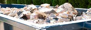 overloaded dumpster