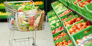 grocery cart full of fruit and vegetables