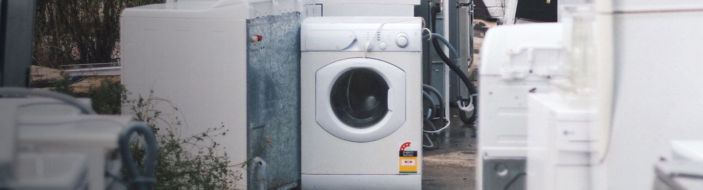 White Washing Machine Surrounded by Other Appliances