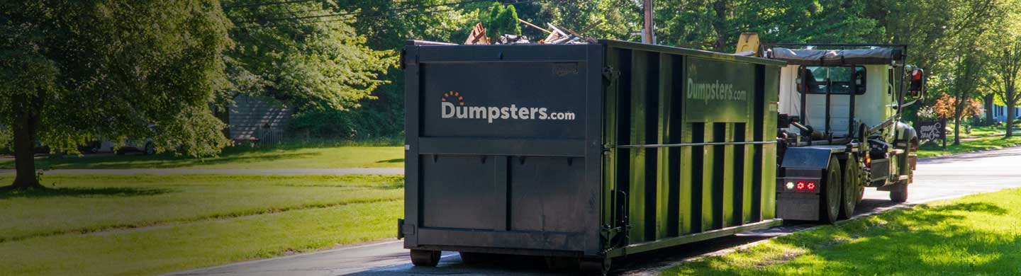 Remodeling Debris in a Dumpsters.com Roll Off Dumpster Placed on a Street.