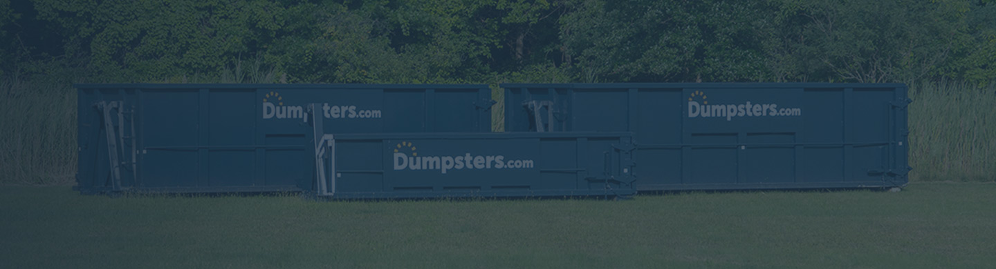 three different sizes of roll off dumpster next to each other in a green field