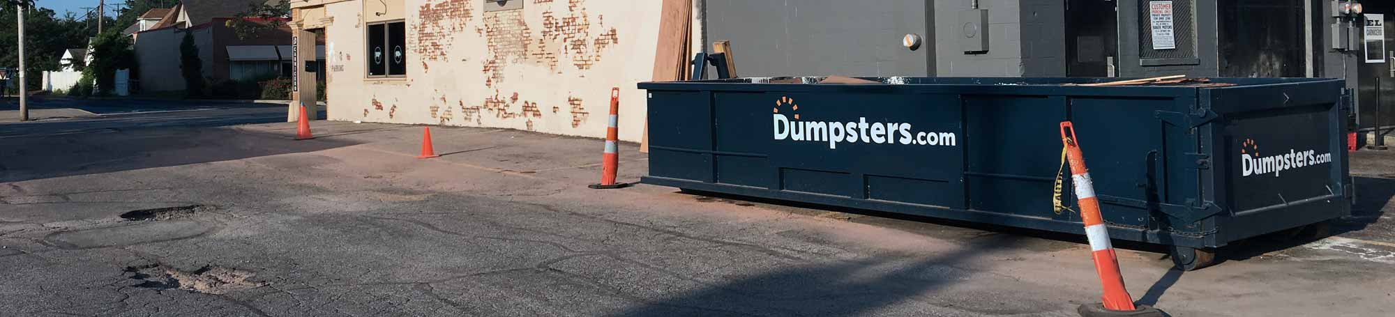 Roll Off Dumpster in Urban Parking Lot.