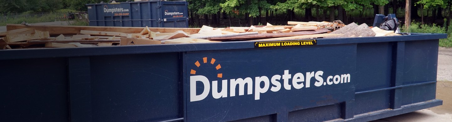 roll off dumpster filled with trash