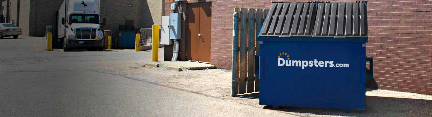 6 Cubic Yard Dumpster in a Commercial Parking Lot