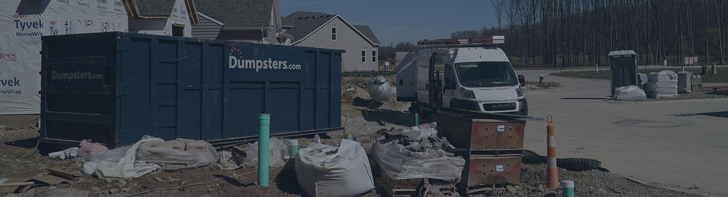 A Dumpsters.com Roll Off Dumpster On-Site at a Home Build.
