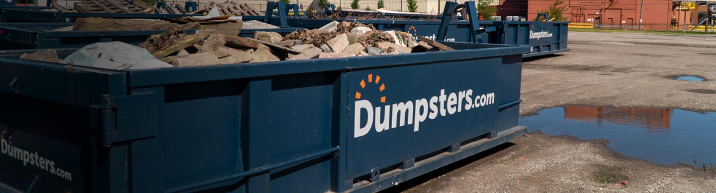 dumpsters.com container full of large slabs of rock