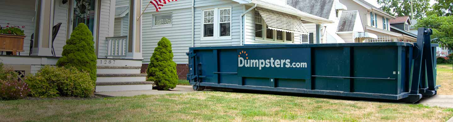 roofing dumpster outside a white house