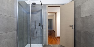 A Modern Shower With Tile and a Glass Door.