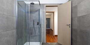 A Shower With Glass Doors and Tile Walls.