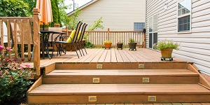 A Wooden Deck Behind a House.