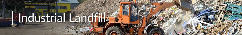A Front-End Loader Sifts Through Construction Debris at an Industrial Landfill.