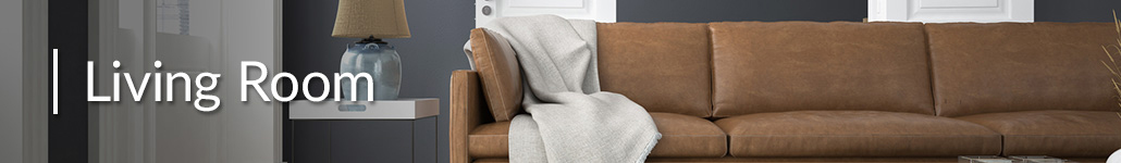 Brown Leather Couch With a White Blanket.