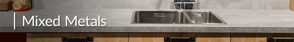 Stainless Steel Sink and Faucet with Black Drawer Handles.