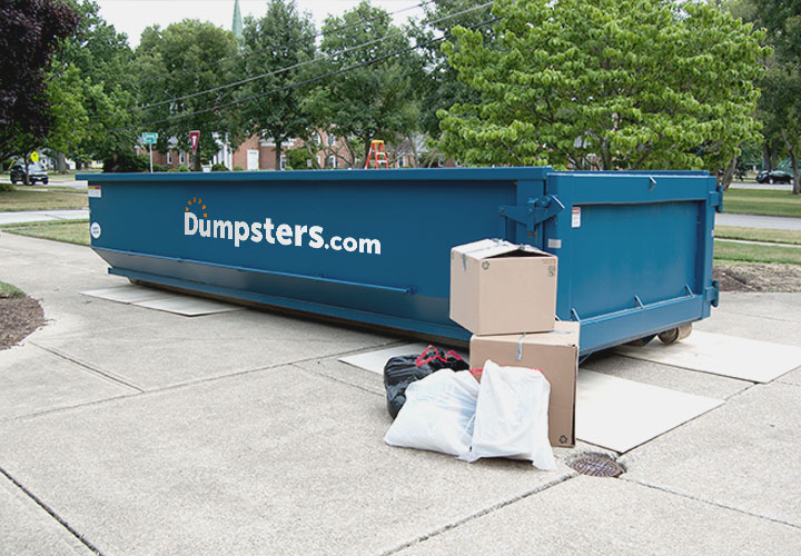 Roll Off Dumpster in Residential Driveway Filled with Household Junk