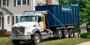 A Blue Dumspters.com Roll Off Dumpster.