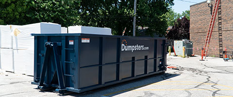 Dumpsters.com Roofing Dumpster on a Job Site