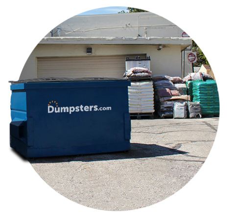 circle image of a dumpster next to a garage and industrial packages