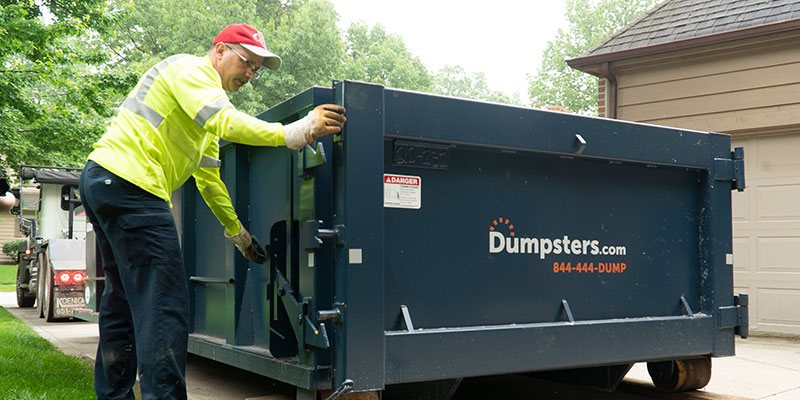 Dumpsters.com Dumpster Truck Driver Matt Snyder Demonstrates How to Open a Roll Off Dumpster Door.