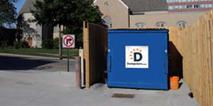 a permanent dumpster inside of a dumpster enclosure