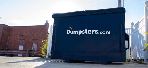 front load dumpster in business parking lot