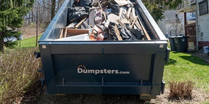 A Roll Off Dumpster Filled With Trash.