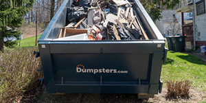 roll off dumpster filled with demolition debris